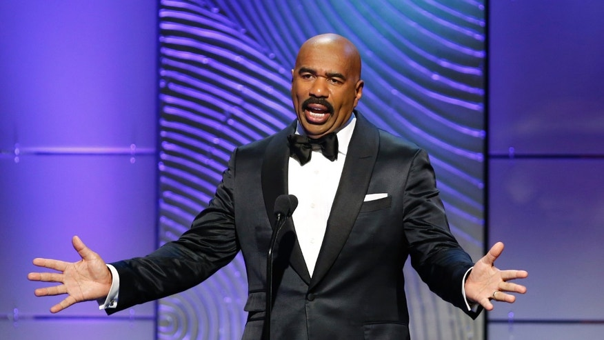 TV host Steve Harvey presents the outstanding morning program award during the 40th annual Daytime Emmy Awards in Beverly Hills, California June 16, 2013.