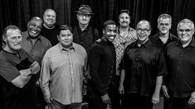 """HOLD FOR RELEASE - This Aug. 2016 photo provided by courtesy of Tower of Power/Webster Public Relations, from left, Rocco Prestia, Roger Smith, Sal Cracchiolo, Adolfo Acosta, Stephen """"Doc"""" Kupka, Marcus Scott, Tom E. Politzer, Emilio Castillo, David Garibaldi, and Jerry Cortez. Two members of Tower of Power, a group that has been an R&B institution for nearly 50 years, were hit by a train Thursday night, Jan. 12, 2017, as they walked across tracks before a scheduled gig in their hometown of Oakland, Calif., but both survived, their manager said. Calling it an ???unfortunate accident,??? manager Jeremy Westby said in a statement that drummer Garibaldi and bass player Marc van Wageningen (not pictured) are ???responsive and being treated at a local hospital.??? (Tower of Power/Webster Public Relations via AP)"""