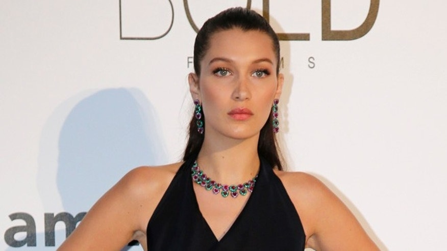 Model Bella Hadid poses during a photocall as she arrives to attend the amfAR's Cinema Against AIDS 2016 event, during the 69th Cannes Film Festival, in Antibes, France, May 19, 2016.