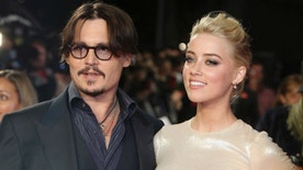 "FILE - In this Nov. 3, 2011 file photo, U.S. actors Johnny Depp, left, and Amber Heard arrive for the European premiere of their film, ""The Rum Diary,"" in London. A Los Angeles judge finalized the actors' divorce, Friday, Jan. 13, 2017, after months of bickering over the final terms of their breakup, although the pair have agreed to honor the terms of a settlement that calls for Depp to pay Heard $7 million, which the actress has said she will donate to two charities. (AP Photo/Joel Ryan, File)"
