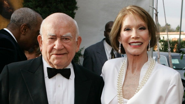 """Ed Asner, left, and Mary Tyler Moore, from television's """"The Mary Tyler Moore Show"""" pose together at the 13th Annual Screen Actors Guild Awards on Sunday, Jan. 28, 2007, in Los Angeles. (AP Photo/Chris Carlson)"""