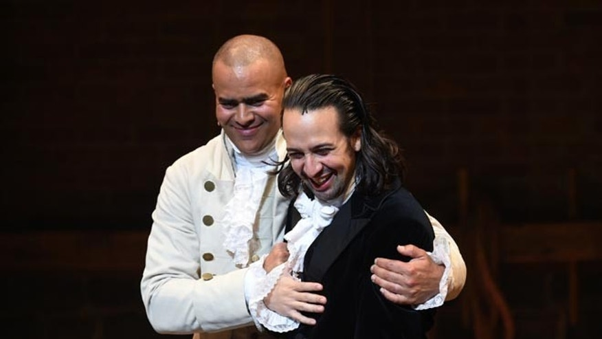 "Actor and ""Hamilton"" creator Lin-Manuel Miranda, right, gets a hug from cast mate Christopher Jackson during his final performance curtain call at the Richard Rogers Theatre on Saturday, July 9, 2016, in New York."