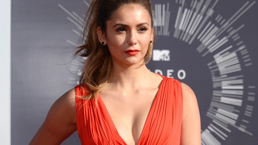 Nina Dobrev arrives at the 2014 MTV Music Video Awards in Inglewood, California August 24, 2014.