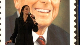 Singer Crystal Gale sings during a dedication ceremony for the launch of a commemorative postage stamp of former President Ronald Reagan, in Washington, February 9, 2005. Reagan, the 40th U.S. President from 1981 to 1989, was honored with the stamp in the year following his death. Reagan passed away in June of 2004 at the age of 93. The stamp will be issued nationwide on February 9. REUTERS/Micah Walter  MW - RTRMUAN