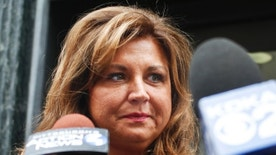 """FILE- In this June 27, 2016, file photo, """"Dance Moms"""" star Abby Lee Miller leaves federal court after pleading guilty in Pittsburgh to bankruptcy fraud and failing to report thousands of dollars in Australian currency she brought into the country. Miller is scheduled to appear in federal court in Pittsburgh on Friday, Jan. 20, 2017, for the start of her sentencing hearing in her bankruptcy fraud case. (AP Photo/Keith Srakocic, File)"""