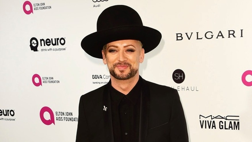 Boy George defended Melania Trump while at Paris Fashion Week.