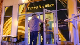 People enter a door leading to the Festival Box Office during the 2017 Sundance Film Festival on Saturday, Jan. 21, 2017, in Park City, Utah. Representatives for the Sundance Film Festival say that their network systems were subject to a cyberattack that caused its box offices to shut down briefly Saturday afternoon. (Photo by Danny Moloshok/Invision/AP)