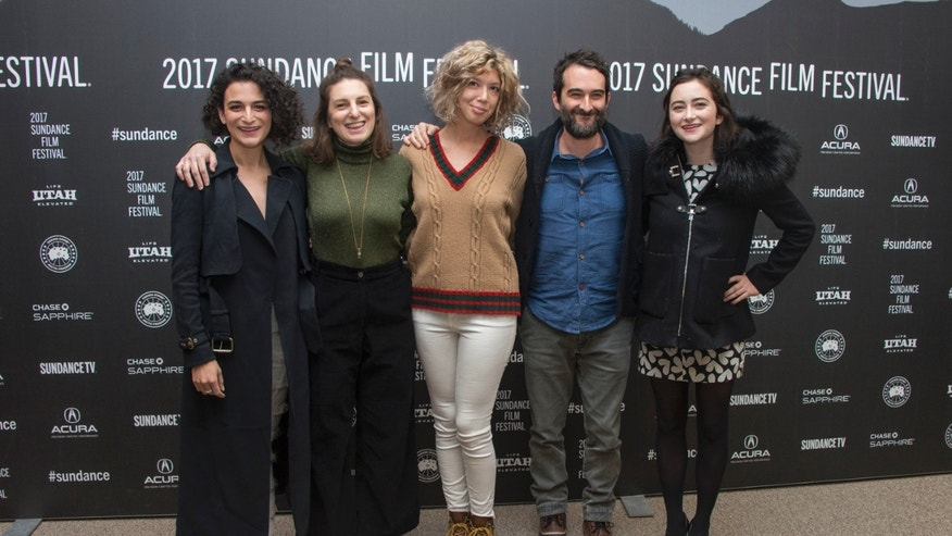 "From left, actress Jenny Slate, director/co-writer Gillian Robespierre, co-writer/producer Elisabeth Holm, actor Jay Duplass and actress Abby Quinn pose at the premiere of the film ""Landline"" at the Eccles Theater during the 2017 Sundance Film Festival on Friday, Jan. 20, 2017, in Park City, Utah. (Photo by Arthur Mola/Invision/AP)"