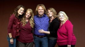 """FILE - In this file publicity photo provided by TLC, Kody Brown, center, poses with his wives, from left, Robyn, Christine, Meri and Janelle, in a promotional photo for the reality series, """"Sister Wives,"""" which aired in March, 2011. When the polygamous family learned in December 2013 that a federal judge in Utah struck down key parts of the state's polygamy laws, Brown and his four wives said they cried and felt deeply emotional. The family says they are grateful for the ruling, but said winning the lawsuit they brought against Utah in July 2011 doesn't ease the pain caused by the significant personal sacrifices they made when they fled the state for Las Vegas under the threat of prosecution. (AP Photo/TLC, George Lange, File)"""