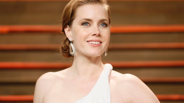 Actress Amy Adams arrives at the 2014 Vanity Fair Oscars Party in West Hollywood, California March 2, 2014.
