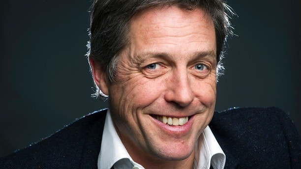 """Actor Hugh Grant poses for a portrait as he promotes his movie """"The Rewrite"""" in the Manhattan borough of New York February 10, 2015."""