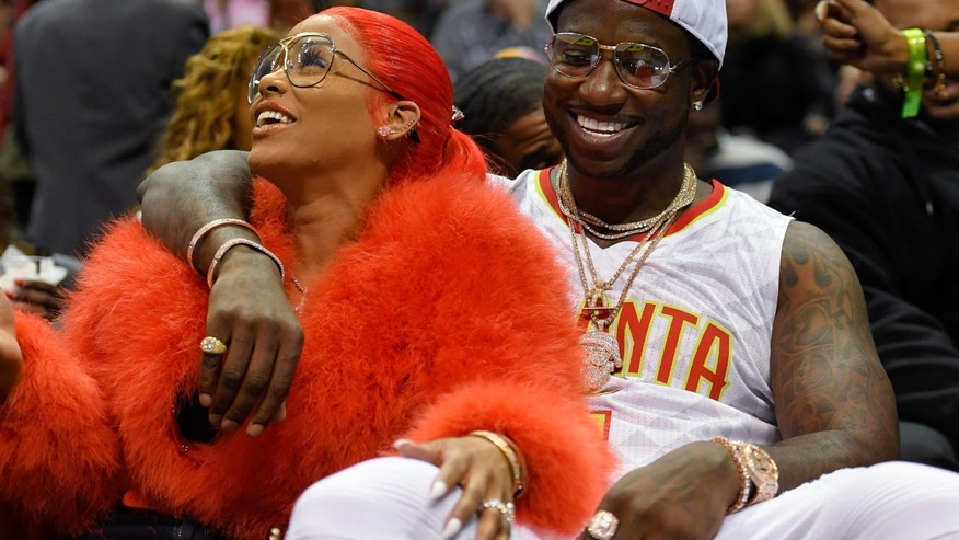 Nov 22, 2016; Atlanta, GA, USA; Recording artist Gucci Mane reacts with Keyshia Ka'oir after being engaged during a time out during the New Orleans Pelicans and Atlanta Hawks game during the second half at Philips Arena. The Pelicans defeated the Hawks 112-96.Mandatory Credit: Dale Zanine-USA TODAY Sports - RTSSVUQ
