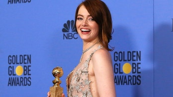 "Emma Stone poses with her award for Best Performance by an Actress in a Motion Picture - Musical or Comedy for her role in ""La La Land"" during the 74th Annual Golden Globe Awards in Beverly Hills, California, U.S., January 8, 2017.  REUTERS/Mario Anzuoni - RTX2Y1PT"