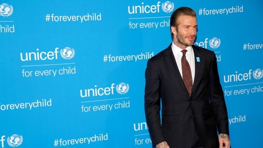David Beckham is denying claims he used his relationship with UNICEF to campaign for knighthood.