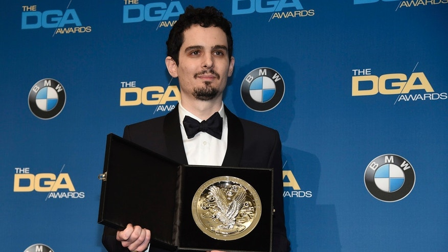 "Damien Chazelle, director of ""La La Land,"" holds his nominee's medallion backstage at the 69th annual Directors Guild of America Awards at the Beverly Hilton on Saturday, Feb. 4, 2017, in Beverly Hills, Calif."