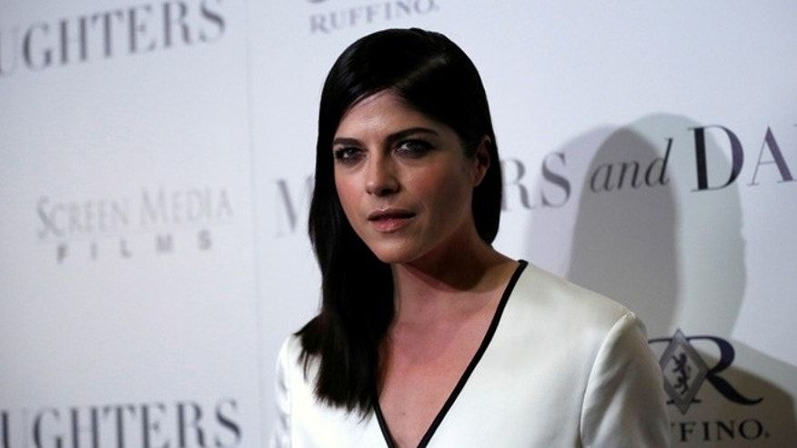 Selma Blair drove away from gas pump while nozzle was still in.
