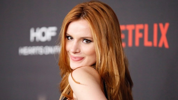 Actress Bella Thorne arrives at The Weinstein Company & Netflix Golden Globe After Party in Beverly Hills, California January 10, 2016.  REUTERS/Danny Moloshok - RTX21SJD