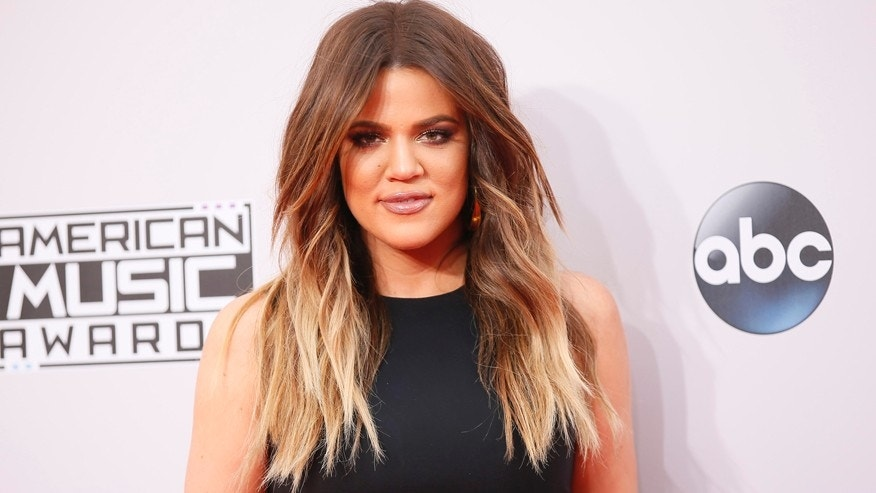 Khloe Kardashian arrives at the 42nd American Music Awards REUTERS