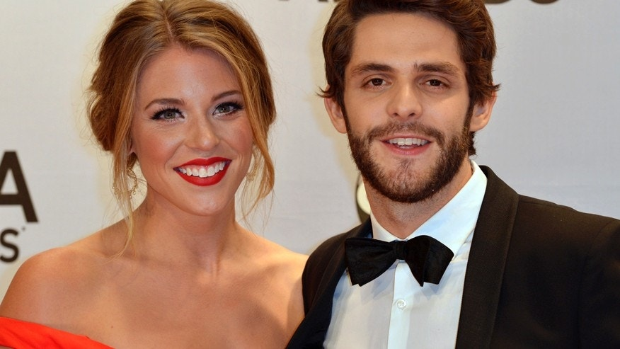 Singer Thomas Rhett arrives with his wife Lauren at the 48th Country Music Association Awards in Nashville, Tennessee November 5, 2014.
