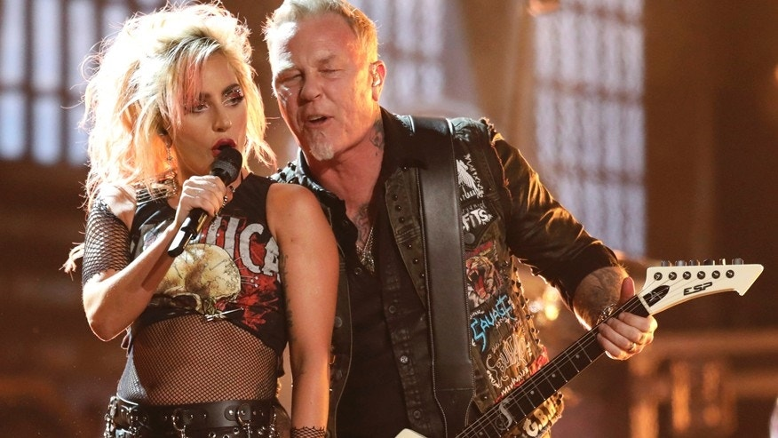 """Lady Gaga, left, and James Hetfield of """"Metallica"""" perform """"Moth Into Flame"""" at the 59th annual Grammy Awards on Sunday, Feb. 12, 2017, in Los Angeles."""