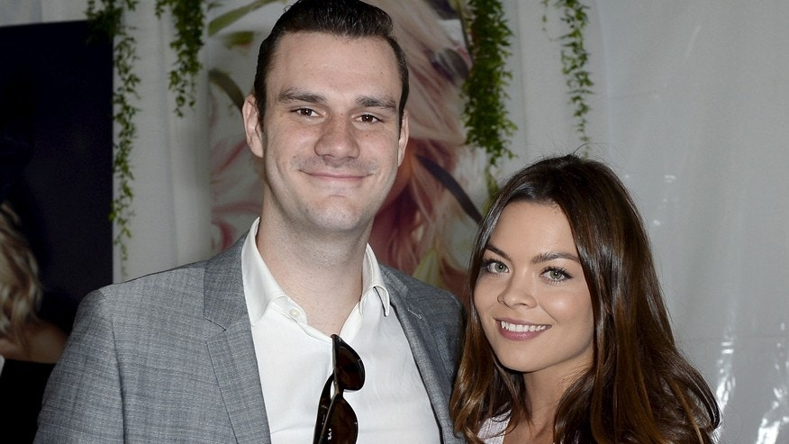 Cooper Hefner (L), son of Playboy founder Hugh Hefner, poses with girlfriend actress Scarlett Byrne, who played Pansy Parkinson in the Harry Potter films, during the announcement of 2015 Playboy Playmate of the Year at a luncheon on the garden grounds of the Playboy Mansion in Los Angeles, California May 14, 2015. REUTERS/Kevork Djansezian - RTX1D12A