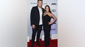 Colton Underwood, left, and Aly Raisman attend the Sports Illustrated Swimsuit 2017 launch event at Center415 on Thursday, Feb. 16, 2017, in New York.
