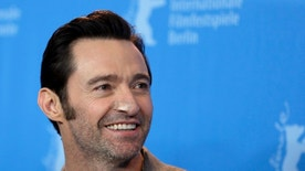 Actor Hugh Jackman poses for the photographers during a photo call for the film 'Logan' at the 2017 Berlinale Film Festival in Berlin, Germany, Friday, Feb. 17, 2017. (AP Photo/Michael Sohn)