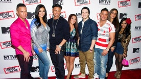 "FILE - In this Oct. 24, 2012 file photo, Jersey Shore cast members, from left to right, Mike ""The Situation"" Sorrentino, Jenni ""JWoww"" Farley, Paul ""Pauly D"" Delvecchio, Deena Cortese, Vinny Guadagnino, Ronnie Ortiz-Magro, Sammi ""Sweetheart"" Giancola and Nicole ""Snooki"" Polizzi pose for photographers at a panel entitled ""Love, Loss, (Gym, Tan) and Laundry: A Farewell to the Jersey Shore""  in New York. Some residents of the New Jersey shore town stung by MTV's ""Jersey Shore"" are wary about plans by a bar featured in that series to hold a casting call for a new reality show. The Bamboo Bar in Seaside Heights is looking for ""loud and fun"" single people at a casting call Saturday, Feb. 18, 2017. (Photo by Charles Sykes/Invision/AP, File)"