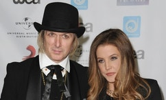 FILE - In this May 10, 2012 file photo, Lisa Marie Presley, at right, and her husband, Michael Lockwood, arrive at NARM Music Biz 2012 Awards, at The Hyatt Regency in Century City, Calif. Presley describes herself as deeply in debt and just out of a treatment facility in court papers that accuse her estranged fourth husband of having hundreds of inappropriate photographs of children on his computer. Their 8-year-old twin daughters are under the care of California child protective services, according to documents filed this month with California Superior Court in Los Angeles related to husband Lockwood's request for spousal support. Lockwood has not been charged with anything and his lawyer said the accusations are inaccurate.  (AP Photo/Katy Winn, File)