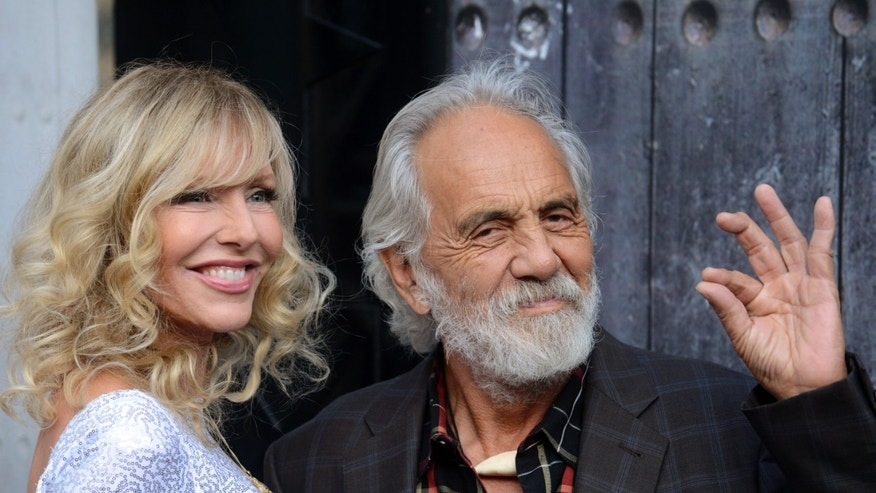 "Comedian Tommy Chong (R) and his wife Shelby Chong attend Spike TV's ""Guys Choice"" awards in Los Angeles June 7, 2014."