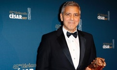 Actor George Clooney poses with the Honorary Cesar award during a photocall at the 42nd Cesar Film Awards ceremony at Salle Pleyel in Paris, Friday, Feb. 24, 2017. This annual ceremony is presented by the French Academy of Cinema Arts and Techniques. (AP Photo/Francois Mori)