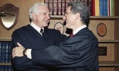 "FILE - In this Friday, Oct. 13, 1989, file photo, retired Judge Joseph A. Wapner of TV's 'The People's Court' congratulates his son, Judge Frederick N. Wapner, right, as he was enrobed as a Municipal Court judge in Los Angeles. Wapner, who presided over ""The People's Court"" with steady force during the heyday of the reality courtroom show, has died. Wapner died at home in his sleep Sunday, Feb. 26, 2017, according to his son, David Wapner. (AP Photo/Nick Ut, File)"