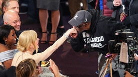"""Gary from Chicago"" kisses the hand of actor Nicole Kidman during a skit at the 89th Annual Academy Awards."