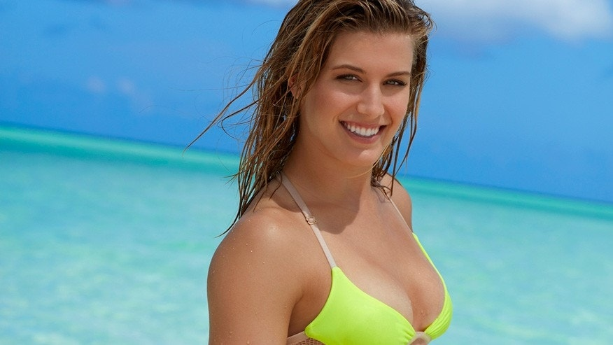 Genie Bouchard poses in a swimsuit for Sports Illustrated.