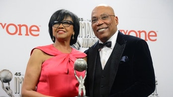 Hall of Fame honorees Cheryl Boone Isaacs (L) and Paris Barclay pose backstage at the 45th NAACP Image Awards in Pasadena, California February 22, 2014. REUTERS/Phil McCarten (UNITED STATES - Tags: ENTERTAINMENT) - RTX19CBN