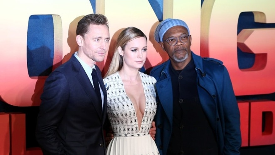 Actors Tom Hiddleston (L), Brie Larson (C) and Samuel L Jackson pose for photographers at the European Premiere of Kong: Skull Island in London, Britain February 28, 2017. REUTERS/Neil Hall - RTS10UDN