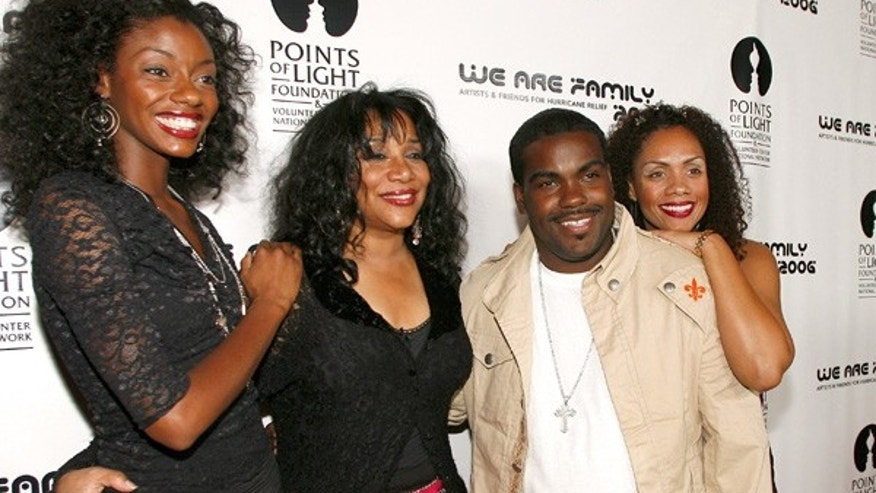 "File- This Aug. 14, 2006 file photo shows Joni Sledge, one of the original members of ""Sister Sledge,"" second from left, posing with Rodney Jerkins, second from right, her niece Camille Sledge, left, and her cousin Amber Sledge at the ""We Are Family 2006 - All-Star Katrina Benefit CD and Documentary DVD Launch"" in Century City, Calif."