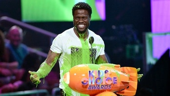"Kevin Hart reacts from being slimed after accepting the award for favorite villain for ""The Secret Life of Pets"" at the Kids' Choice Awards at the Galen Center on Saturday, March 11, 2017, in Los Angeles. (Photo by Chris Pizzello/Invision/AP)"