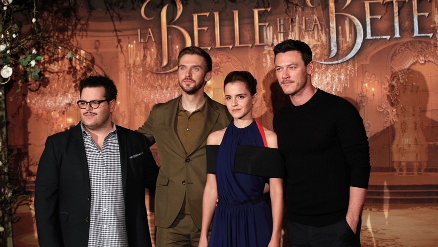 From left actor Josh Gad, Dan Stevens, Actress Emma Watson and Luke Evans pose during a photocall for the movie La belle et la bete (beauty and the beast), in Paris, Monday, Feb. 20, 2017. (AP Photo/Christophe Ena)