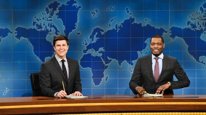 "In this March 4, 2017 photo provided by NBC, Colin Jost and Michael Che, right, appear during Weekend Update segment of ""Saturday Night Live"" in New York. ""Saturday Night Live"" gets the summer off but ""Weekend Update"" will keep the political satire coming in prime-time. NBC said Tuesday, March 14, 2017, that four episodes of ""Saturday Night Live: Weekend Update"" will air at 9 p.m. Thursday starting Aug. 10."