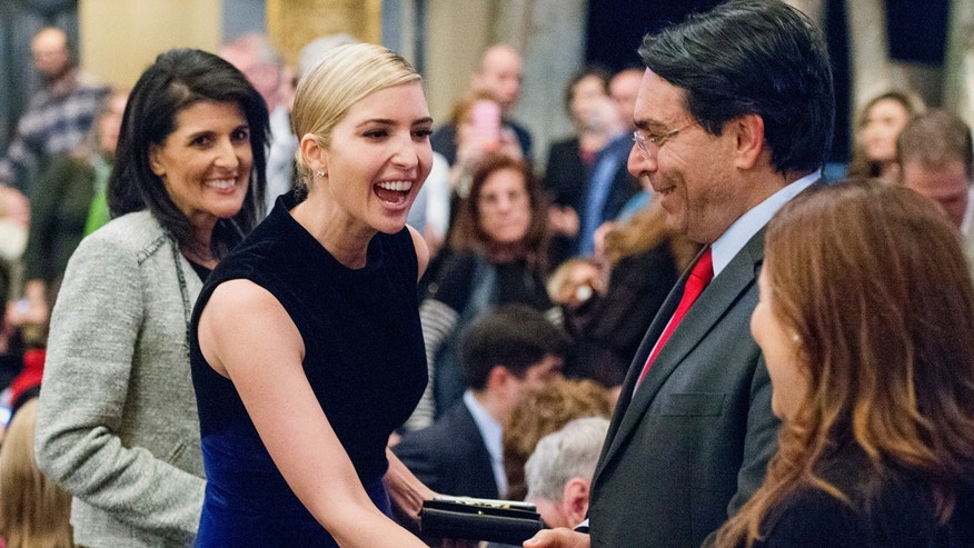 "Ivanka Trump greets patrons as the United States Ambassador to the United Nations Nikki Haley, left, looks on before the start of the Broadway musical ""Come From Away"" in New York, Wednesday, March 15, 2017."