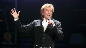 "FILE - In this March 17, 2016 file photo, Barry Manilow performs in concert during his ""One Last Time! Tour 2016"" in Hershey, Pa. The Grammy Award-winning singer of such songs as ""Mandy,"" ""I Write the Songs"" and ""Looks Like We Made It"" will appear at the next monthly ""Concert for America: Stand Up, Sing Out!"" on April 18 at The Town Hall in New York. It also will be streamed live on Facebook. (Photo by Owen Sweeney/Invision/AP, File)"