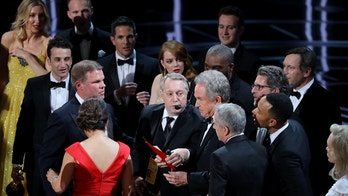 "89th Academy Awards - Oscars Awards Show - Hollywood, California, U.S. - 26/02/17 - Warren Beatty holds the card for the Best Picture Oscar awarded to ""Moonlight,"" after announcing by mistake that ""La La Land"" was winner. REUTERS/Lucy Nicholson  TPX IMAGES OF THE DAY - RTS10IF0"