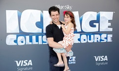 """Cast member Max Greenfield (L) and his daughter Lily pose at a screening of the movie """"Ice Age: Collision Course"""" at the Fox Studios Lot in Los Angeles, California, U.S., July 16, 2016. REUTERS/Danny Moloshok - RTSIBNF"""
