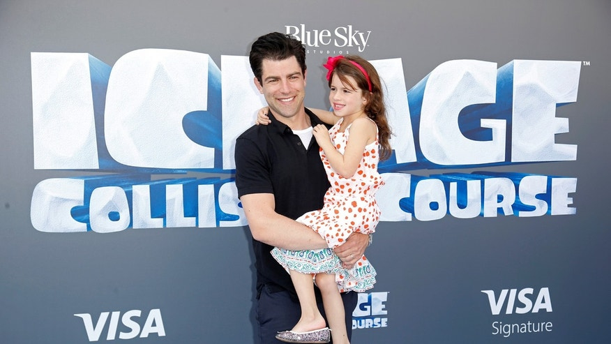 "Cast member Max Greenfield (L) and his daughter Lily pose at a screening of the movie ""Ice Age: Collision Course"" at the Fox Studios Lot in Los Angeles, California, U.S., July 16, 2016. REUTERS/Danny Moloshok - RTSIBNF"