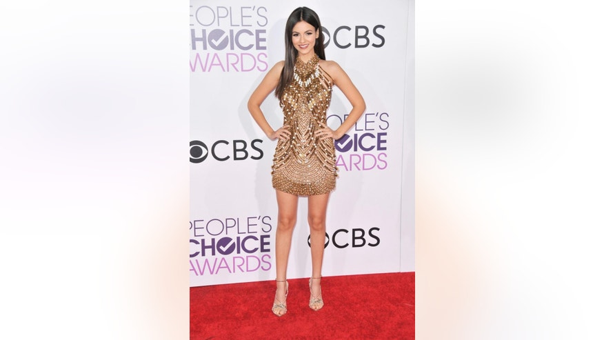 Victoria Justice poses on the red carpet.