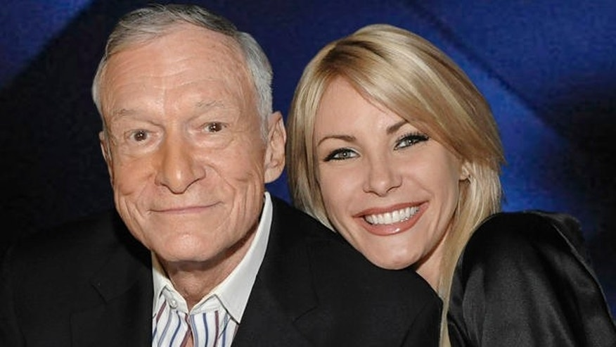 "Hugh Hefner, left, and model Crystal Harris at a party celebrating the release of the book ""Hugh Hefner's Playboy"" a limited edition anthology by Taschen in Beverly Hills, Calif. on Thursday, Dec. 10, 2009.  (AP Photo/Dan Steinberg)"