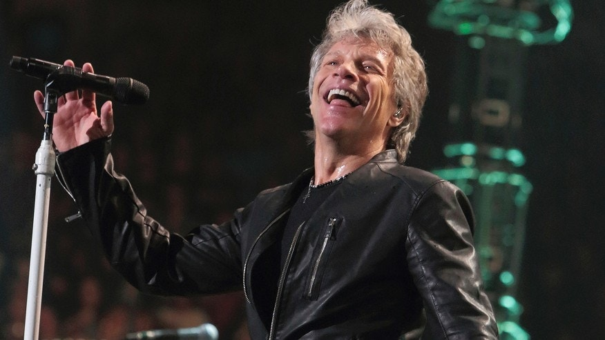 "In this Friday, March 31, 2017, file photo, Jon Bon Jovi of the band Bon Jovi performs in concert during their ""This House Is Not for Sale Tour"" at The Wells Fargo Center in Philadelphia. The group was performing at PPG Paints Arena in Pittsburgh on Wednesday, April 5, 2017, when Jon Bon Jovi told the audience he has had a cold since Saturday night and wrapped things up after 90 minutes of the expected two-and-a-half hour show."