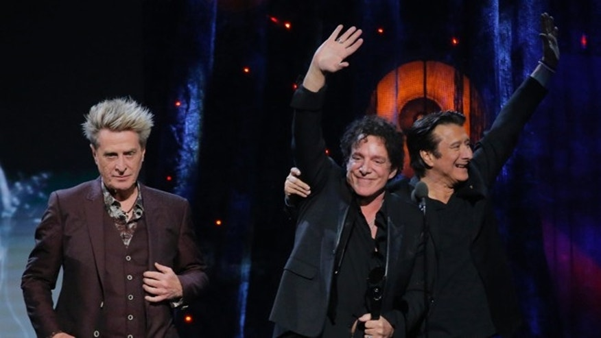 Ross Valory, Neal Schon and Steve Perry of Journey were inducted into the Rock and Roll Hall of Fame on Friday night.