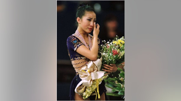Fifteen-year-old Michelle Kwan of the United States cries on the podium after winning the gold medal at the World Figure Skating Championships March 23 in Edmonton.